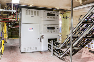 Brown Boveri Generator-output terminal cubicle situated under the generator, with six 15 kV Insulated conductors in two cable trays. Rossdale #8 generator.